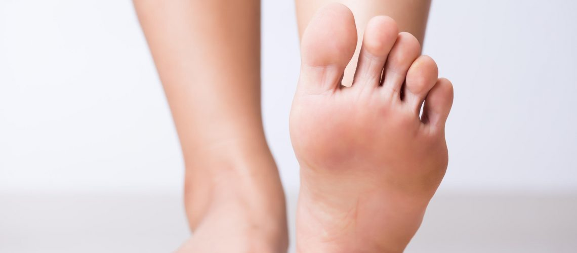 Closeup female foot pain, Healthcare concept.